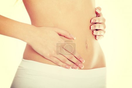 Photo for Perfect beautiful body of young girl , isolatedon a white background - Royalty Free Image