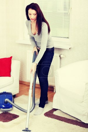 Woman vacuum cleaning.