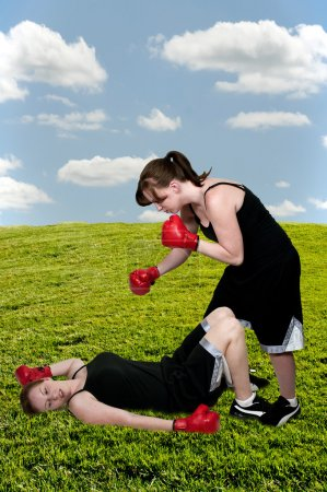 Photo for Beautiful young unconcious knocked out woman boxer with gloves - Royalty Free Image