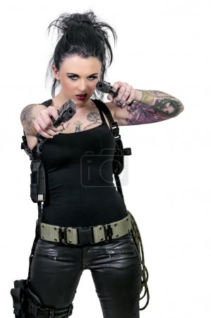 Photo for Beautiful woman with guns shooting stuff - Royalty Free Image