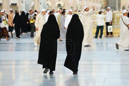 Two Muslim women walking