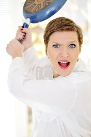 Mad woman with pan in hands