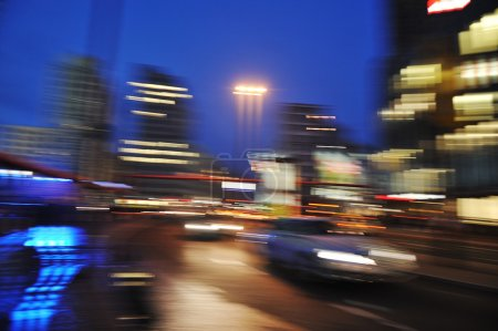 Cars motion on street in the downtown at night (blurred scene)