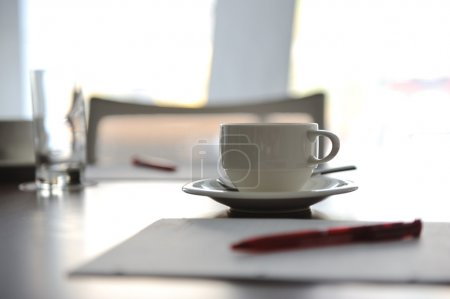 Cup of coffee on table in the conference room