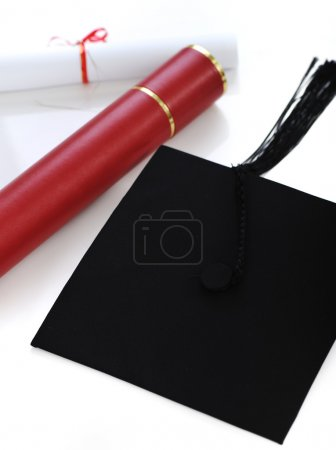 Diploma and graduating cap