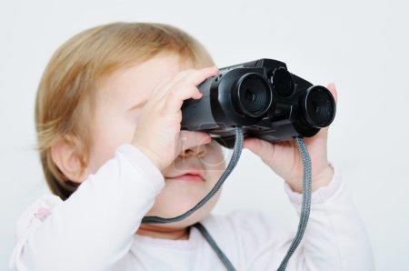 Baby with binoculars