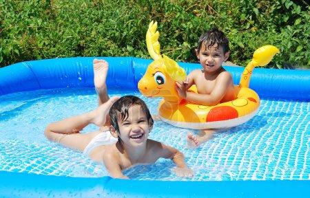 Children activities on swiming pool in summer