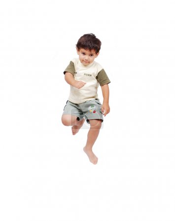 Happy little child in white clothes is jumping isolated