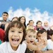 Crowd of children, different ages and races in fro...