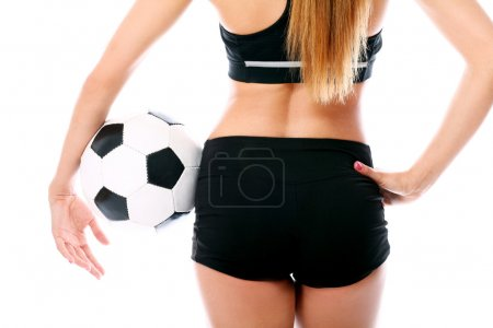 Young and sexy girl`s body with soccer ball