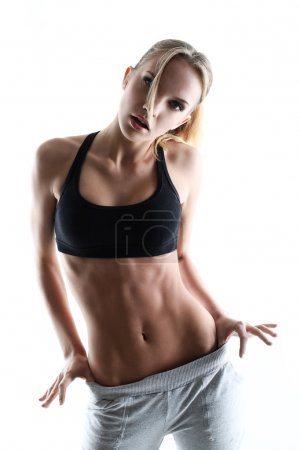 Sporty and attractive woman posing
