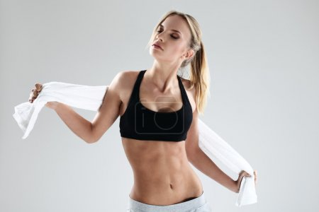 Sporty and attractive fitness woman with towel