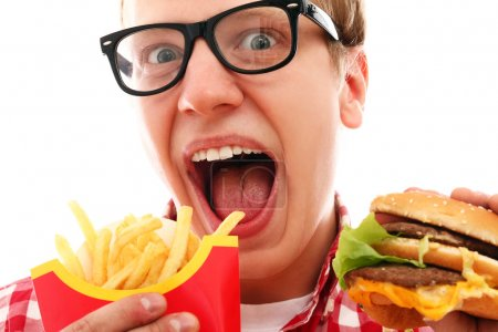 Funny man with french fries and hamburger