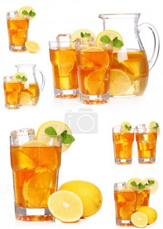 Photo for Fresh and cold ice tea with sliced lemon and mint - Royalty Free Image