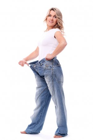 Mid aged woman in big pants after weight losing