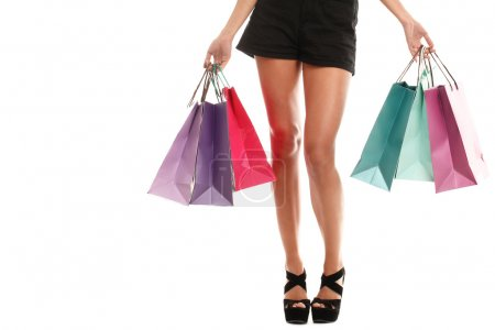 Woman legs in shoes and shopping bags