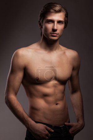 Handsome young man with naked torso
