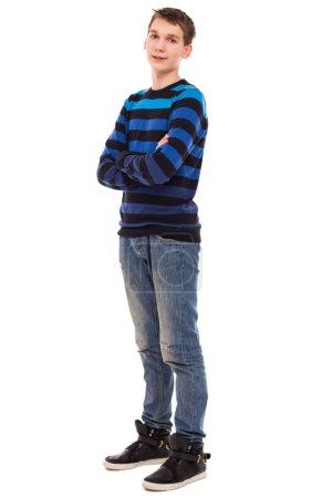 Happy teenager boy in casual standing