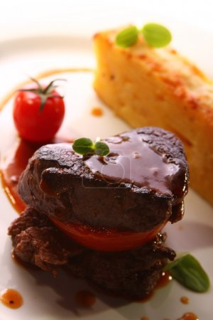 Photo for Grilled meat served with potatoes in a gourmet style - Royalty Free Image