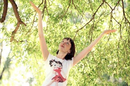 Woman hanging near a tree