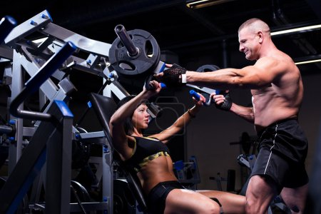 Couple working out at a gym