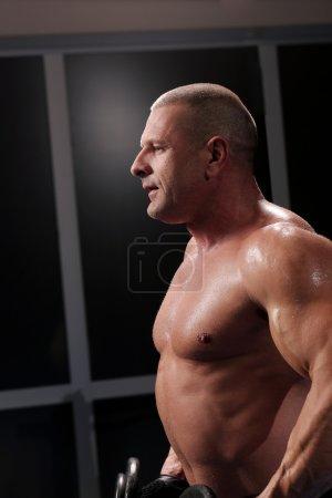 Handsome muscular man at a gym
