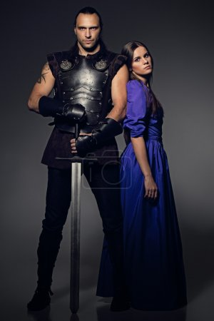 Couple with sword and historical costumes