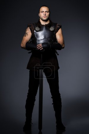 Photo for Young man with sword and historical costume - Royalty Free Image
