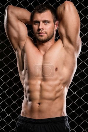 Photo for Fitness. Beautiful, strong man and his muscles - Royalty Free Image