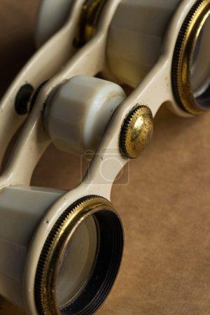 White binoculars on the table
