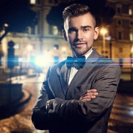 Gentleman in black suit on street