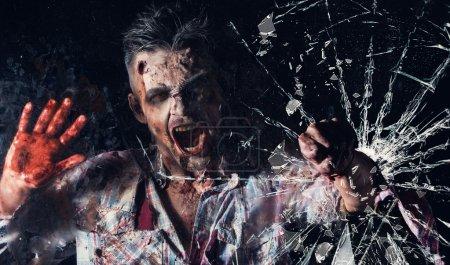 Creepy zombie breaks window