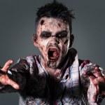 Aggressive, creepy zombie in clothes...