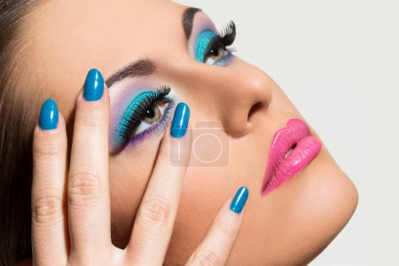Beautiful woman with colorful makeup
