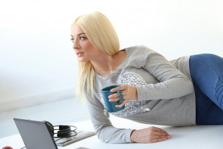 Blonde with laptop and cup of coffee