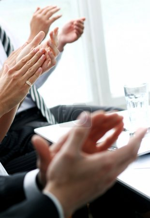 Hands of businesspeople applauding during a meeting