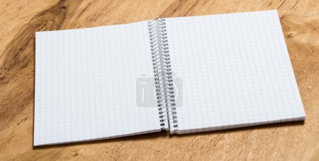 Photo for White notepad on the table - Royalty Free Image