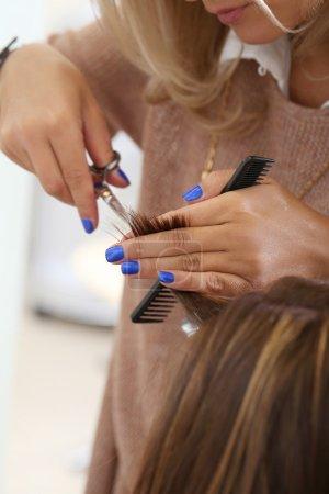 Woman during haircut