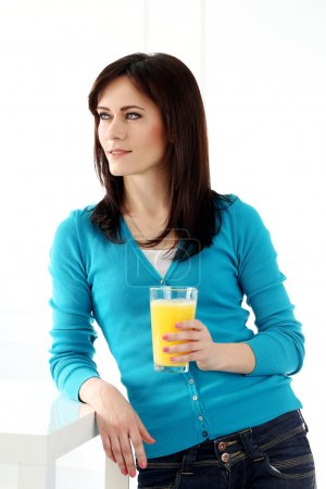 Beautiful woman in blue with juice