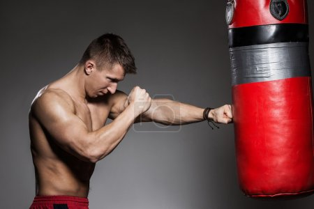 Photo for Bodybuilding. Attractive strong man with boxing bag - Royalty Free Image