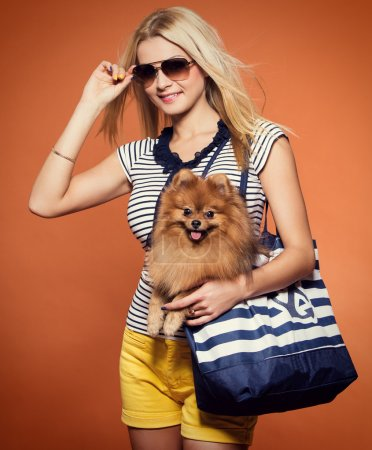 Attractive woman with spitz dog
