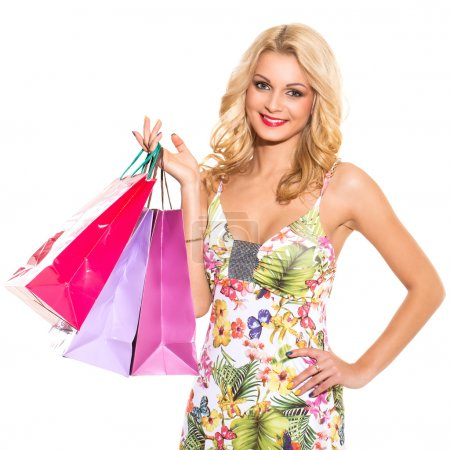 Photo for Vogue. Attractive woman in cute dress with shopping bags on a white background - Royalty Free Image