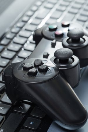 Photo for Electronic devices. Laptop with joystick - Royalty Free Image