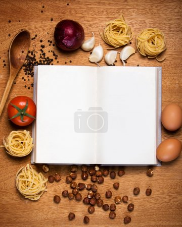 Photo for Kitchen. Cooking book and food on the table - Royalty Free Image