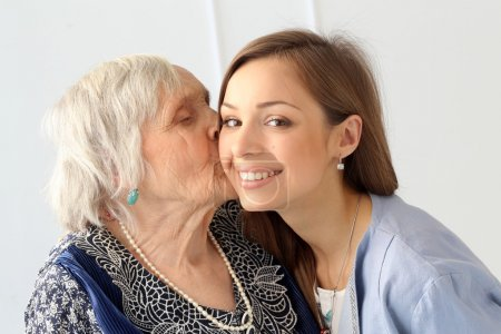 Elderly woman and granddaughter