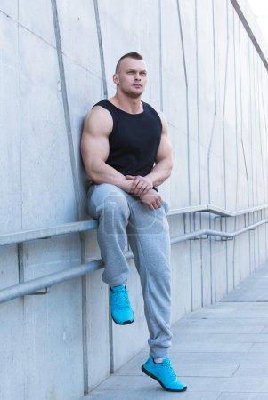 Powerful fitness man on street