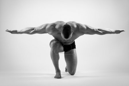 Photo for Fitness, bodybuilding. Powerful man on a white background - Royalty Free Image