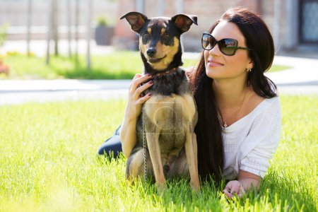 Attractive girl with beautiful dog