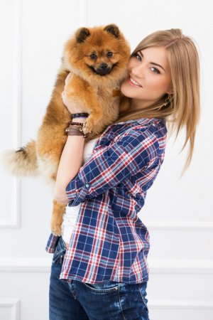 Girl with fluffy dog