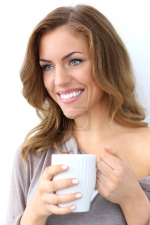 Beautiful girl with cup of tea